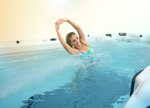 Exercise in the water of a swim spa