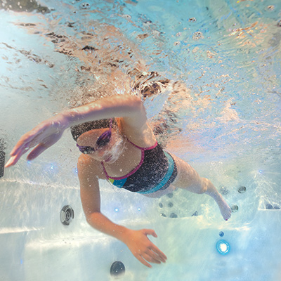 Girl swimming in an H2X swim spa