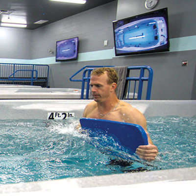 Man walking against water current in swim spa