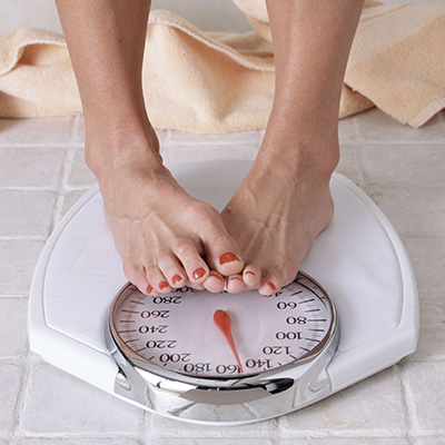 Close up of weighing scale with feet on it