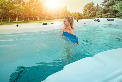 Exercising is easy and convenient in a swim spa